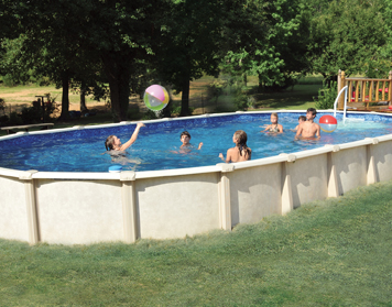 Family swimming in an above-ground pool during the summer